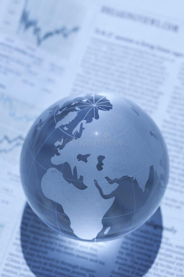 Globo e jornal imagem de stock