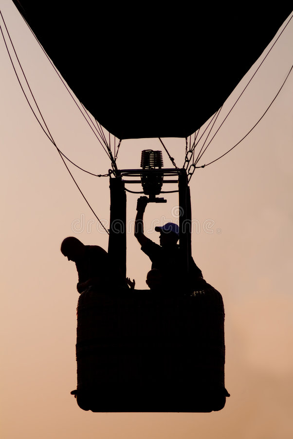 Globo Sillouette del aire caliente fotos de archivo