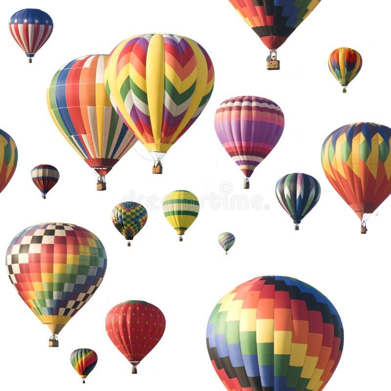 Globos de aire caliente coloridos que flotan contra blanco fotos de archivo libres de regalías