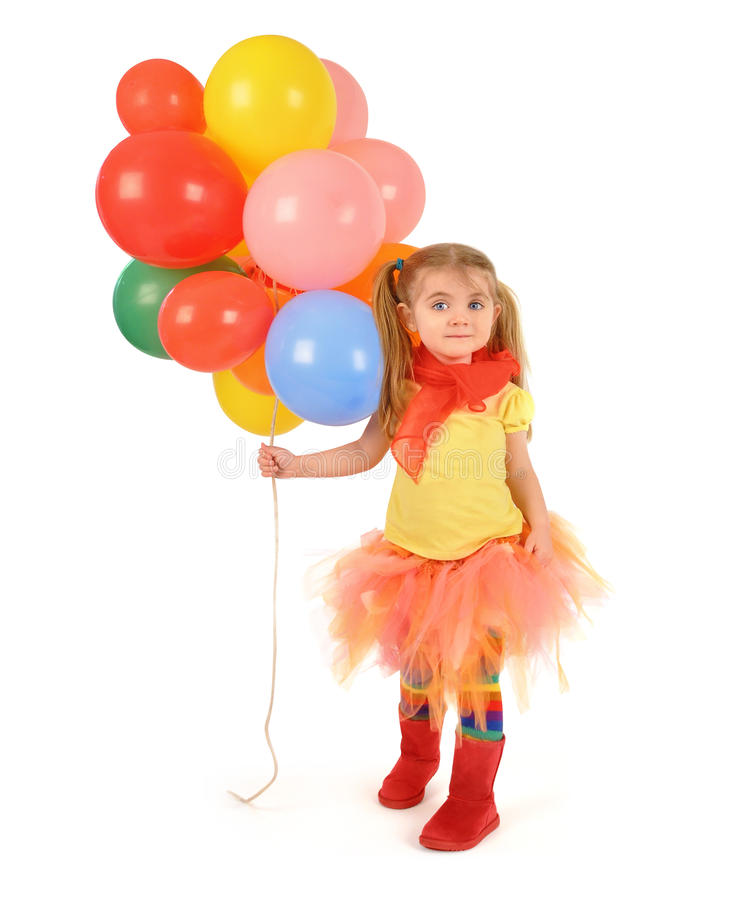 Globos del partido de la tenencia de la niña en blanco fotografía de archivo libre de regalías