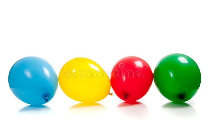 Globos multicolores en blanco fotografía de archivo
