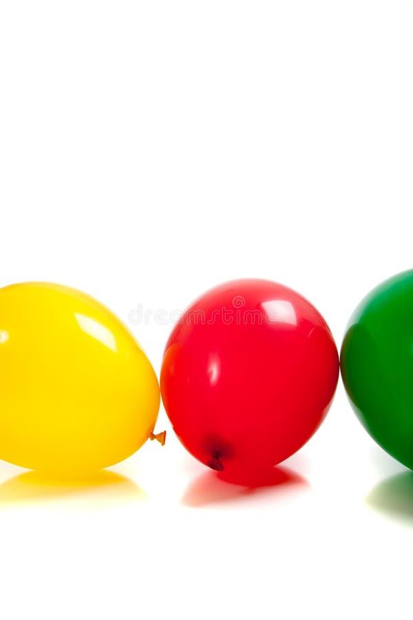 Globos multicolores en blanco fotografía de archivo libre de regalías
