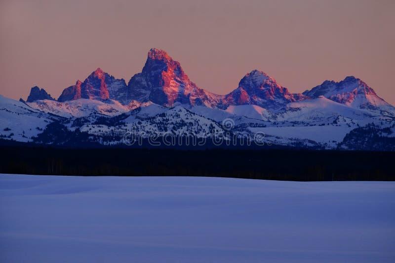 Gloed van zonsondergang de Lichte Alpen op de Bergen van Tetons Teton royalty-vrije stock afbeelding