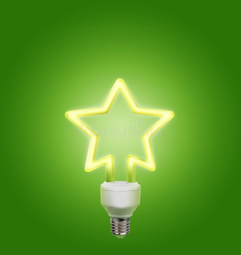 Gloeilamp in de vorm van een ster op een groene achtergrond wordt gemaakt die royalty-vrije stock afbeelding