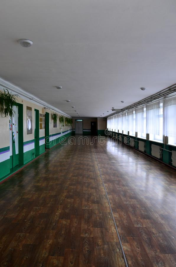 The gloomy corridor of a neglected public building. Public space in a poor residential high-rise buildin. G stock photos