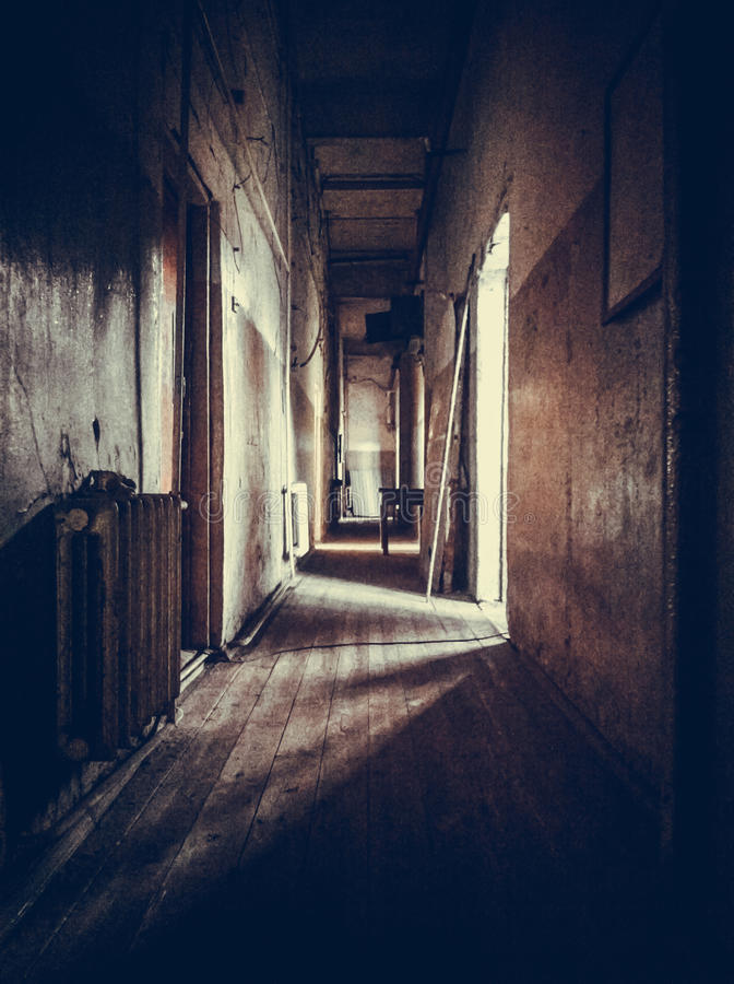 The gloomy corridor in the old house stock image