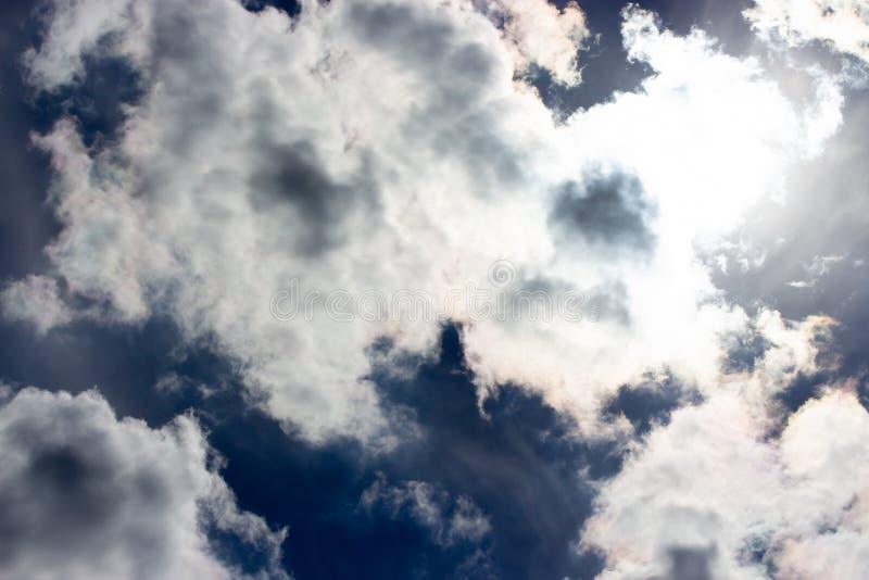Gloomy dark dramatic sky white heaped clouds. Blue cloudscape backdrop, beautiful dramatic dark blue heaven skies. Gloomy dark dramatic sky with white heaped stock photos