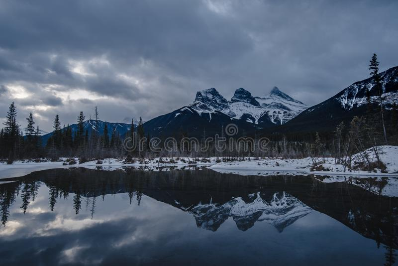 Gloomy day with the Three Sisters Reflecting on the Water stock images