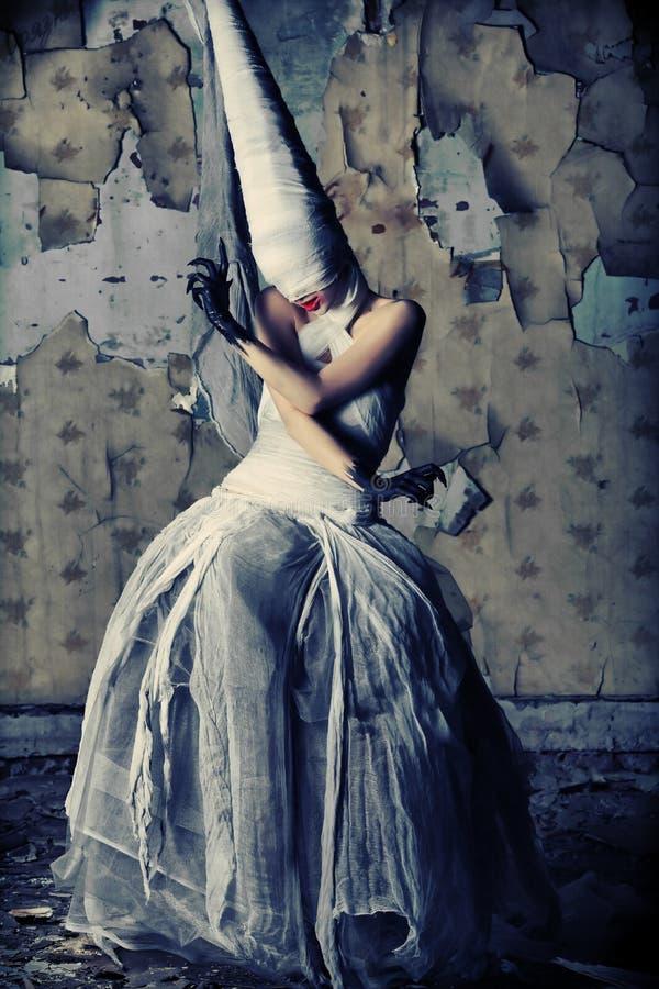 Gloomy girl. Shot of a twilight girl in white dress. Halloween, horror royalty free stock photography