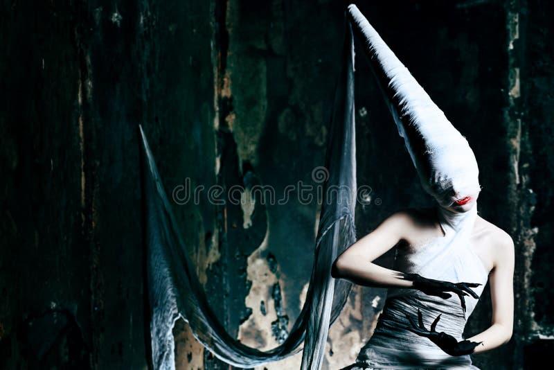 Gloomy girl. Shot of a twilight girl in white dress. Halloween, horror royalty free stock photos