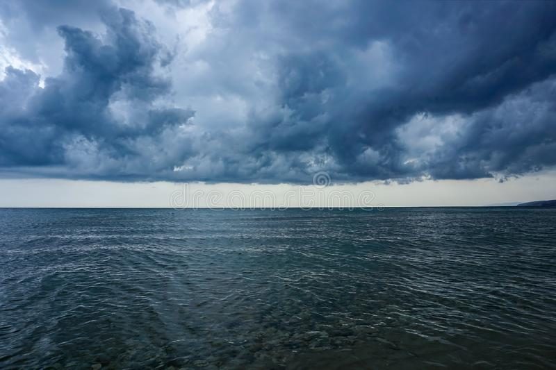 Gloomy, gray, the sky over the sea before the storm royalty free stock photos