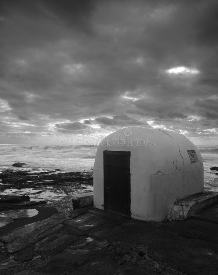 Gloomy image of a pumphouse of a rocky outcrop stock images