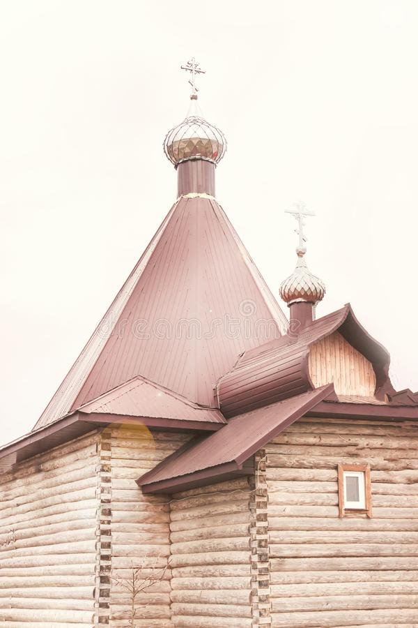 Gloomy morning. wooden church. Metal domes. Retro style stock photography