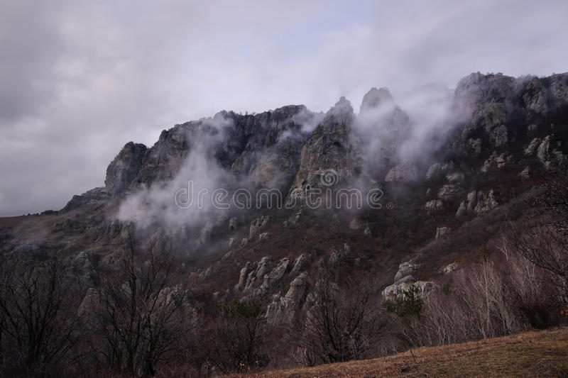 Gloomy mountains. Dark mountains in fog and clouds. Ghost Valley, Crimea royalty free stock photos