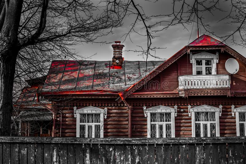 Gloomy old village house on a monochromatic background.. Tinted royalty free stock images