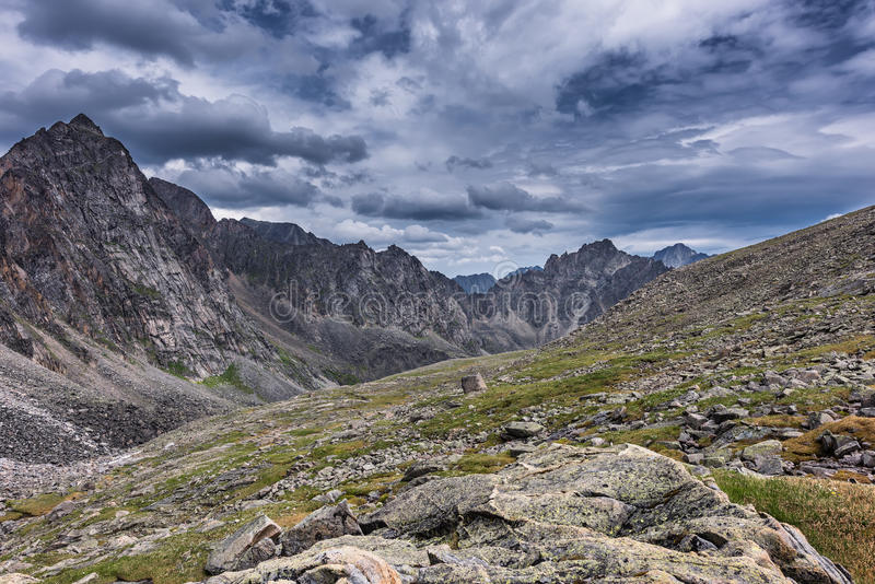 Gloomy skies over the slopes of the mountain tundra, in July. stock photography