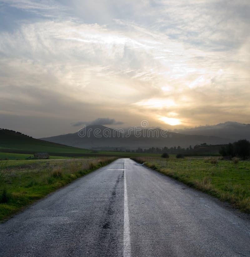 Gloomy sunset on the empty road stock photo