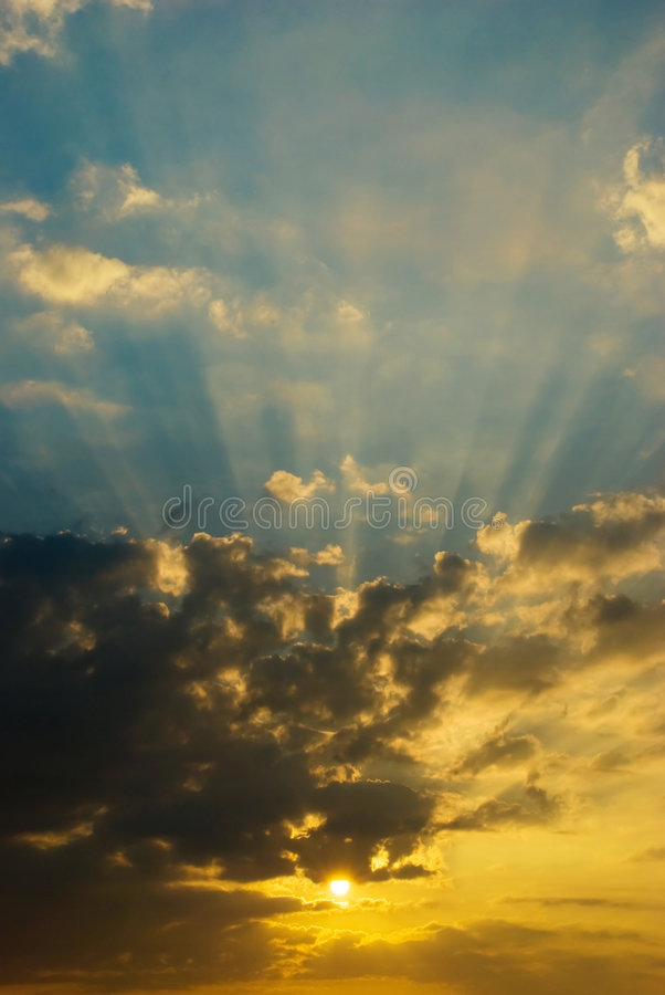 Glorious Morning. Glorious sunbeams emanating from a sun as it crosses the horizon at dawn stock photos