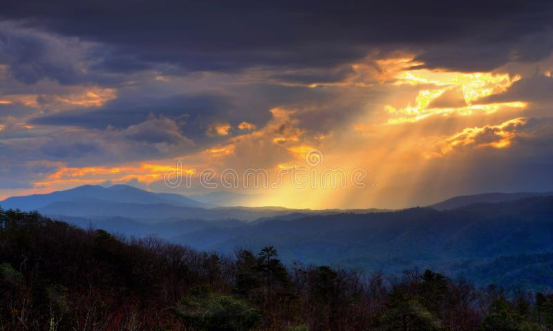 Glorious Morning Light In The Smoky Mountains. A wonderful display of sunlight breaking through the clouds on a cool spring morning in the Smoky Mountains of royalty free stock image