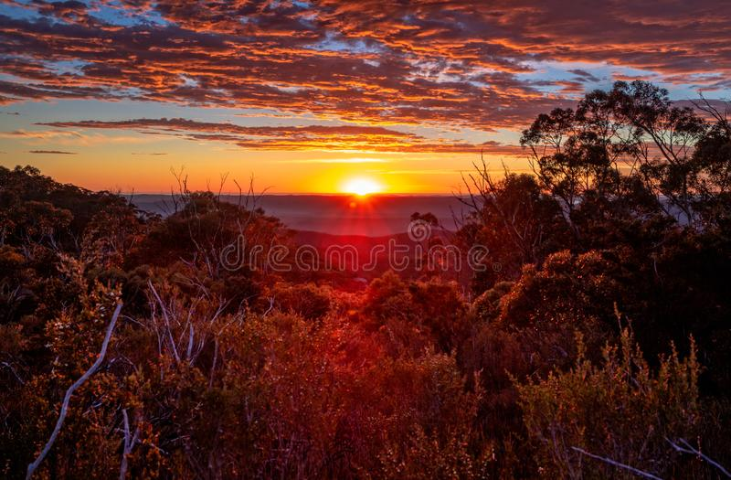 Glorious sunrise views to horizon across mountain ranges. Glorious morning sunrise views across mountain bushland and across to distant ranges stock images