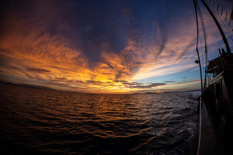 Glorious Sunset in Raja Ampat. A stunning sunset occurs in Raja Ampat, Indonesia. This remote region is home to extraordinary marine biodiversity and is called ' stock image