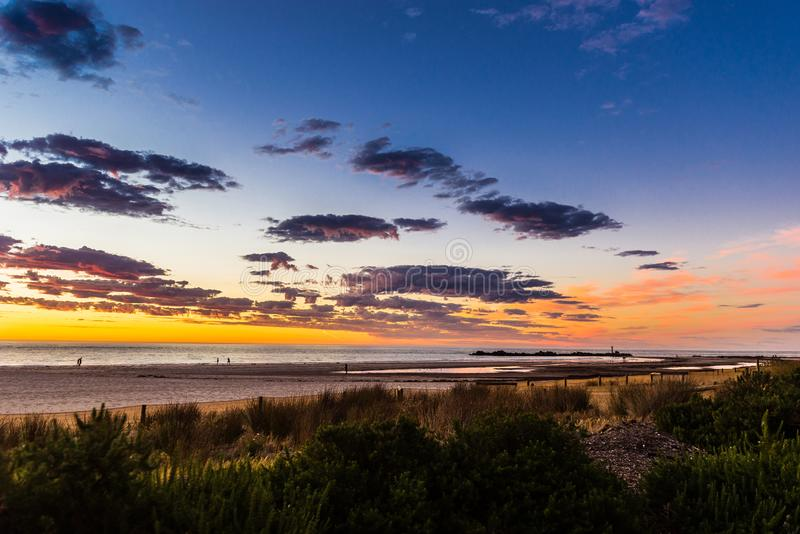 Glorious sunset seascape at Glenelg beach, Adelaide, Australia. Evening sunset landscape sun on a background of cloudy sky and sea stock images
