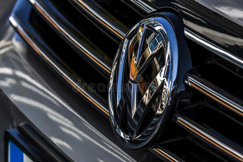 Trademark of VolksWagen on the front side of a car - Editorial photo royalty free stock photo