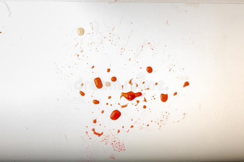 Glossy red liquid droplets, splatters isolated. drops of red juice on white dirty background stock images