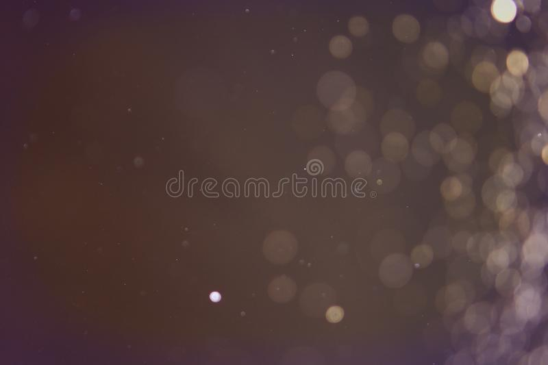 Glossy sparks one side frame bokeh texture - wonderful abstract photo background. Wonderful bright lights one side frame bokeh texture - abstract photo royalty free stock photography
