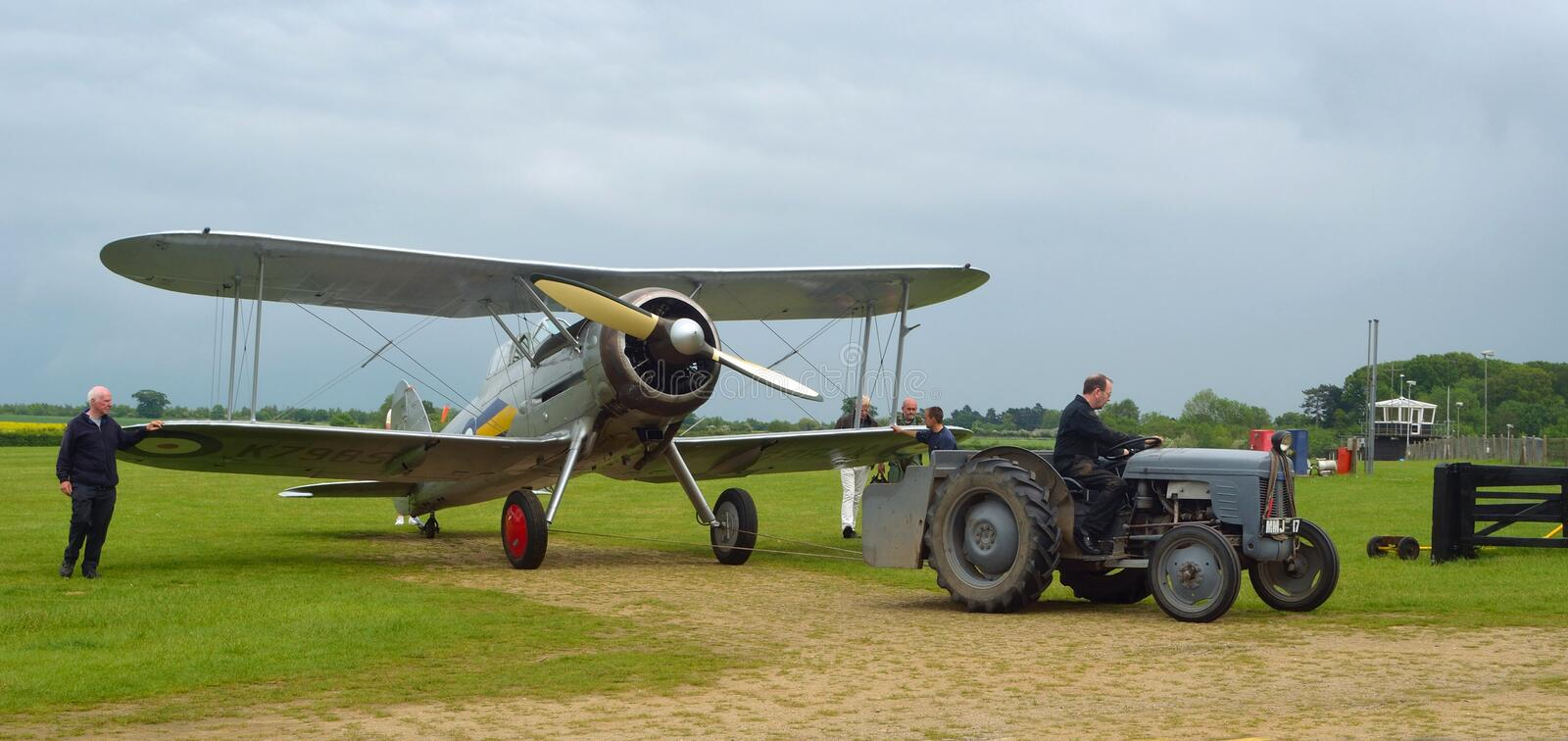 Gloster Gladiator being towed to hanger. royalty free stock image