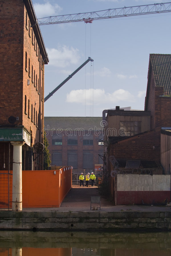 Gloucester Docks Redevelopment. Historic Gloucester Docks undergoing dramatic redevelopment program. Image shows cranes and supervisors on site stock images