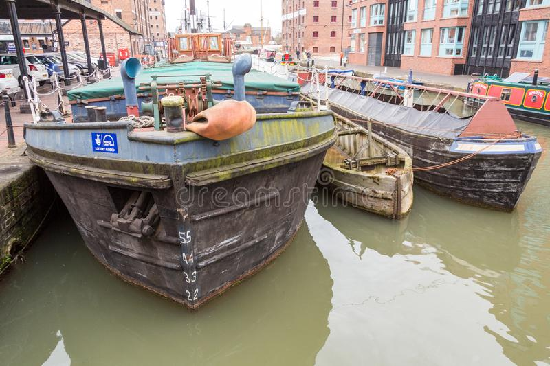 Barges in Gloucester Docks. Gloucester, United Kingdom - March 28, 2015: An overcast SPring day in Gloucester in the West Country of England are the Gloucester royalty free stock photos