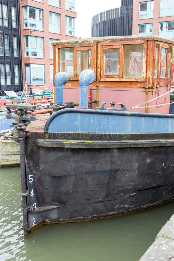 Barges in Gloucester Docks. Gloucester, United Kingdom - March 28, 2015: An overcast Spring day in Gloucester in the West Country of England are the Gloucester royalty free stock photo