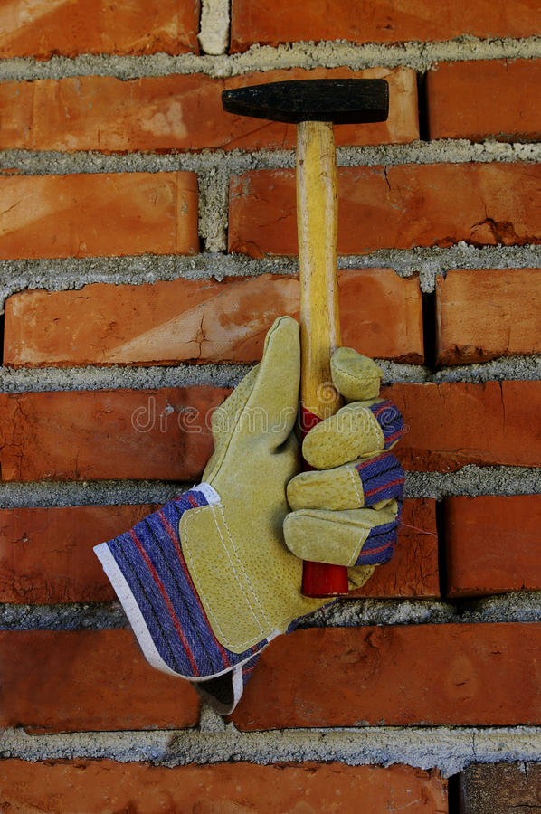 Glove and hammer royalty free stock photography