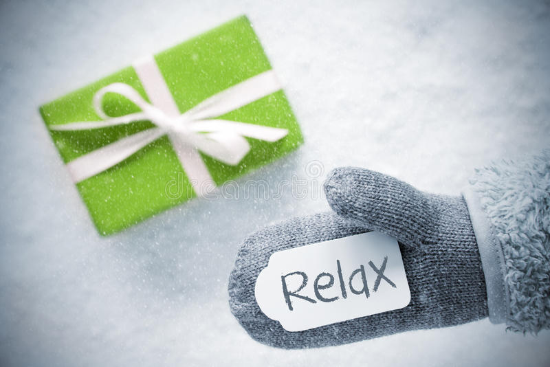Green Gift, Glove, Text Relax, Snowflakes royalty free stock photo