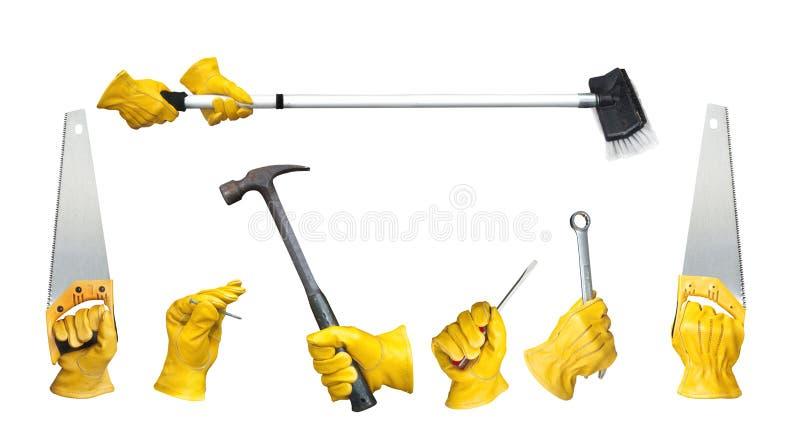 Gloved инструменты удерживания рук стоковая фотография rf