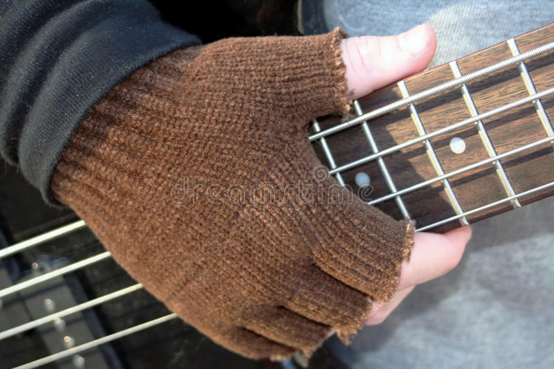 Gloved Hand on Frets royalty free stock photos