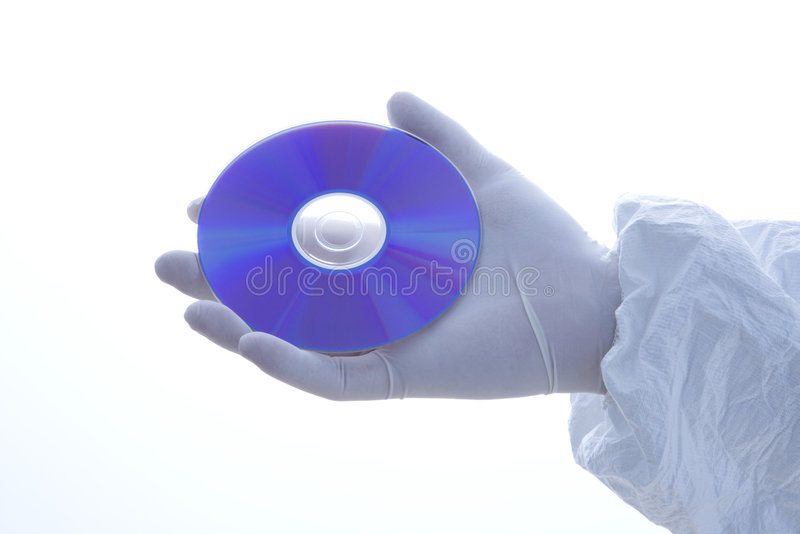 Gloved hand holding disc. royalty free stock photography