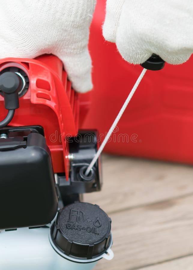 Gloved hand includes a lawnmower, close-up stock photos