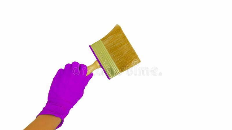Gloved hand with paint brush white isolated background stock photos