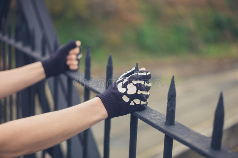 Gloved hands grabbing railings. The gloved hands of a young person is grabbing some railings stock images