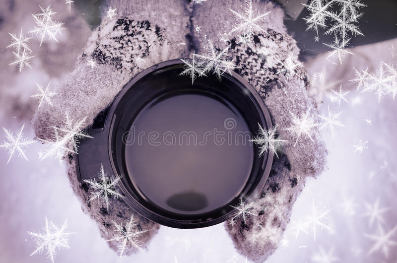 Download Gloved Mitten Hand Holding A Travel Mug. Stock Photo - Image: 83719085