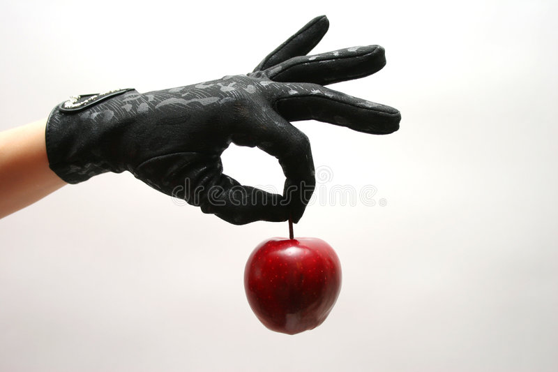 Gloves & Apple stock photography