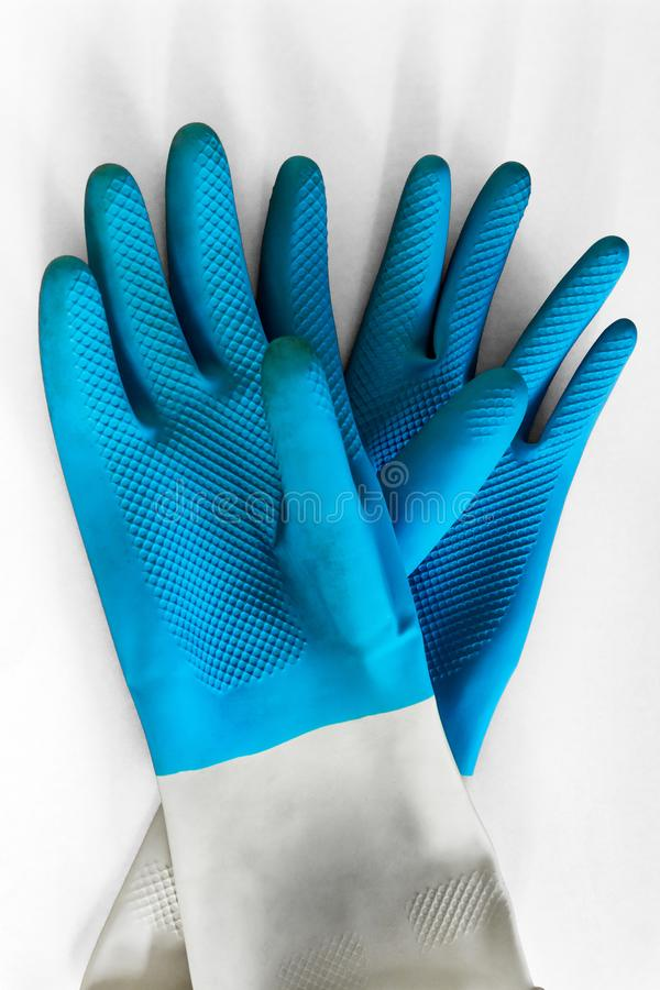 Gloves blue for cleaning and protection of hands, on white background. garden work, work with the ground, aggressive cleaning royalty free stock images