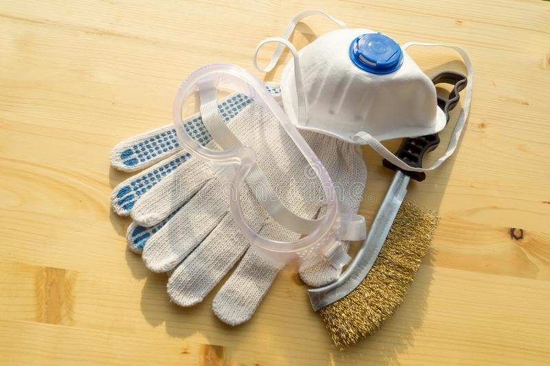 Gloves, brush, glasses, mask on board royalty free stock photos