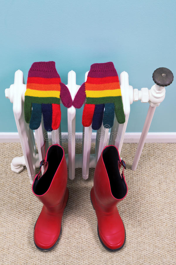 Download Gloves And Wellies On An Old Radiator Stock Image - Image: 21620415