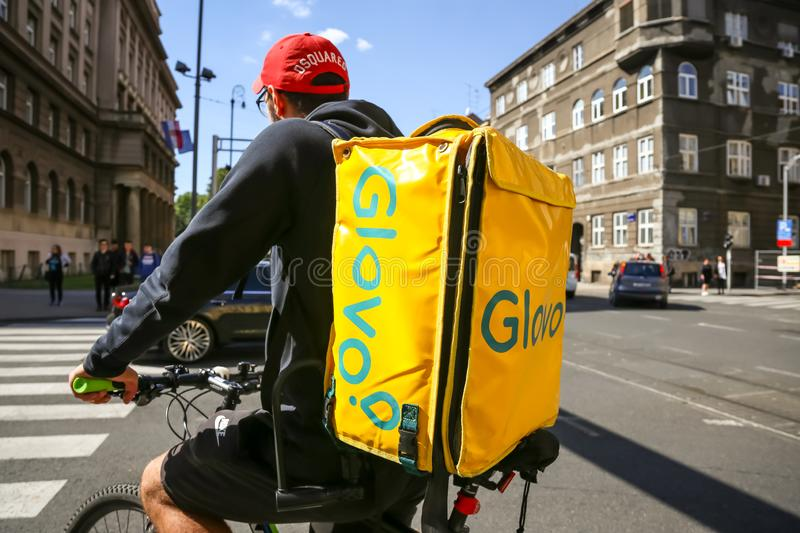 Glovo worker on the bike royalty free stock photo