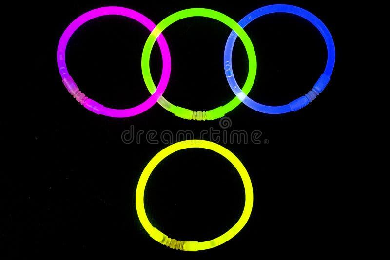 Glow sticks fluorescent lights. Glow sticks neon light fluorescent on back background. variation of different colored chem lights stock photos