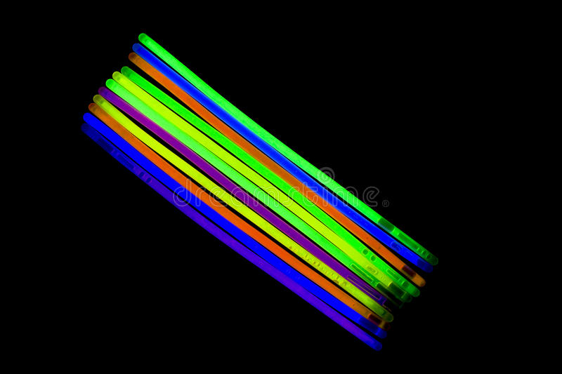 Glow sticks fluorescent lights. Glow sticks neon light fluorescent on back background. variation of different colored chem lights stock photography