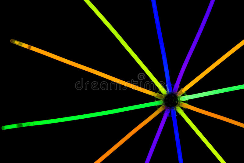 Glow sticks fluorescent lights. Glow sticks neon light fluorescent on back background. variation of different colored chem lights like the sun or star stock images